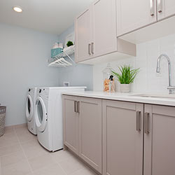 Laundry room - Landmark Homes' front garage showhome