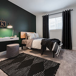 One of three secondary bedrooms – Pacesetter Homes' front garage showhome